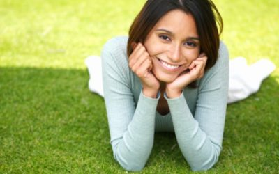 image of smiling woman laying on the grass